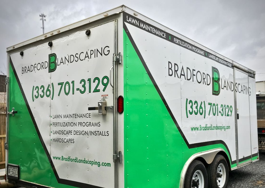 bradford_landscaping_lawn_maintenance_trailer_left_back_angle_view_vehicle_wrap