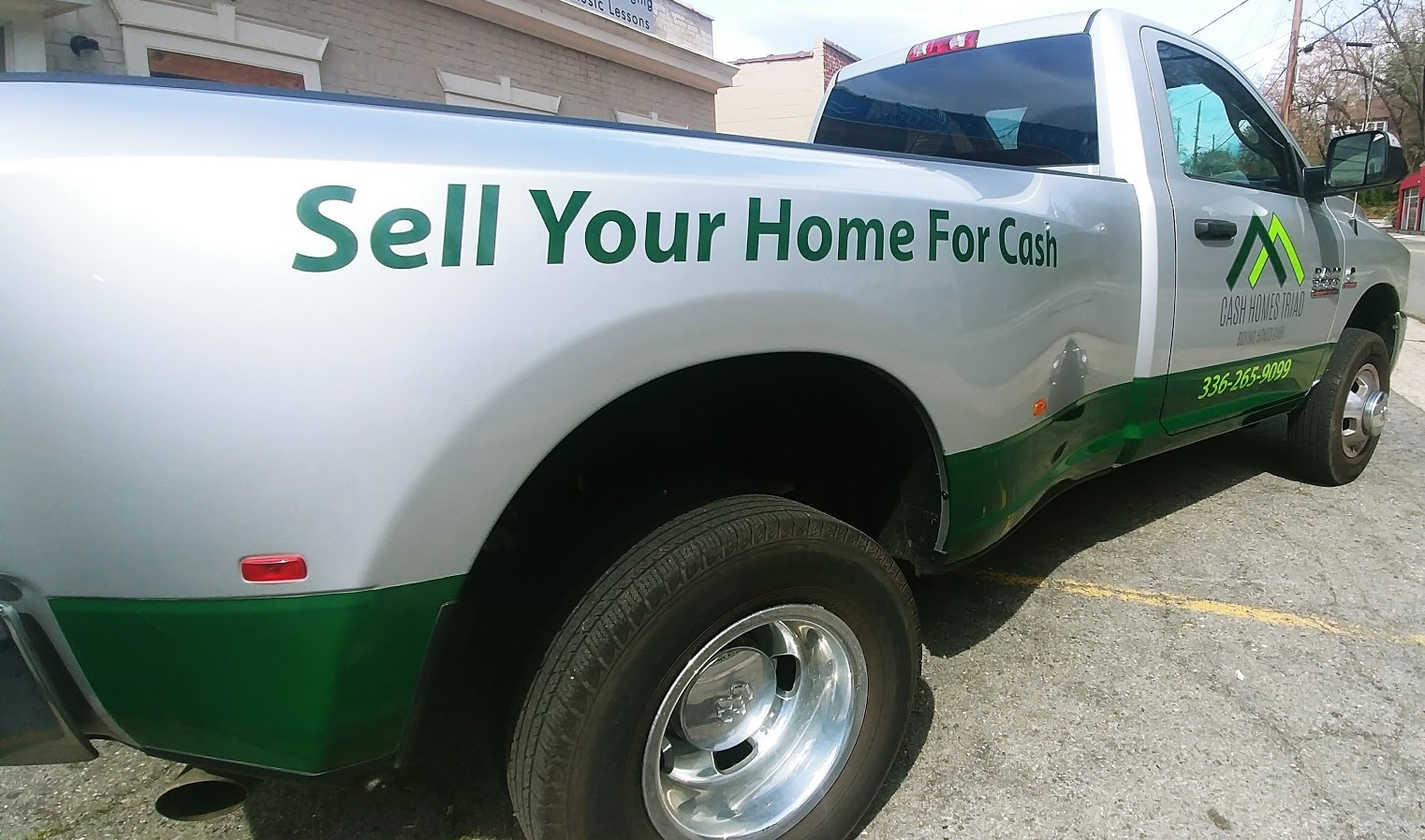 cash_homes_triad_truck_vehicle_wrap_back_left_angle_view
