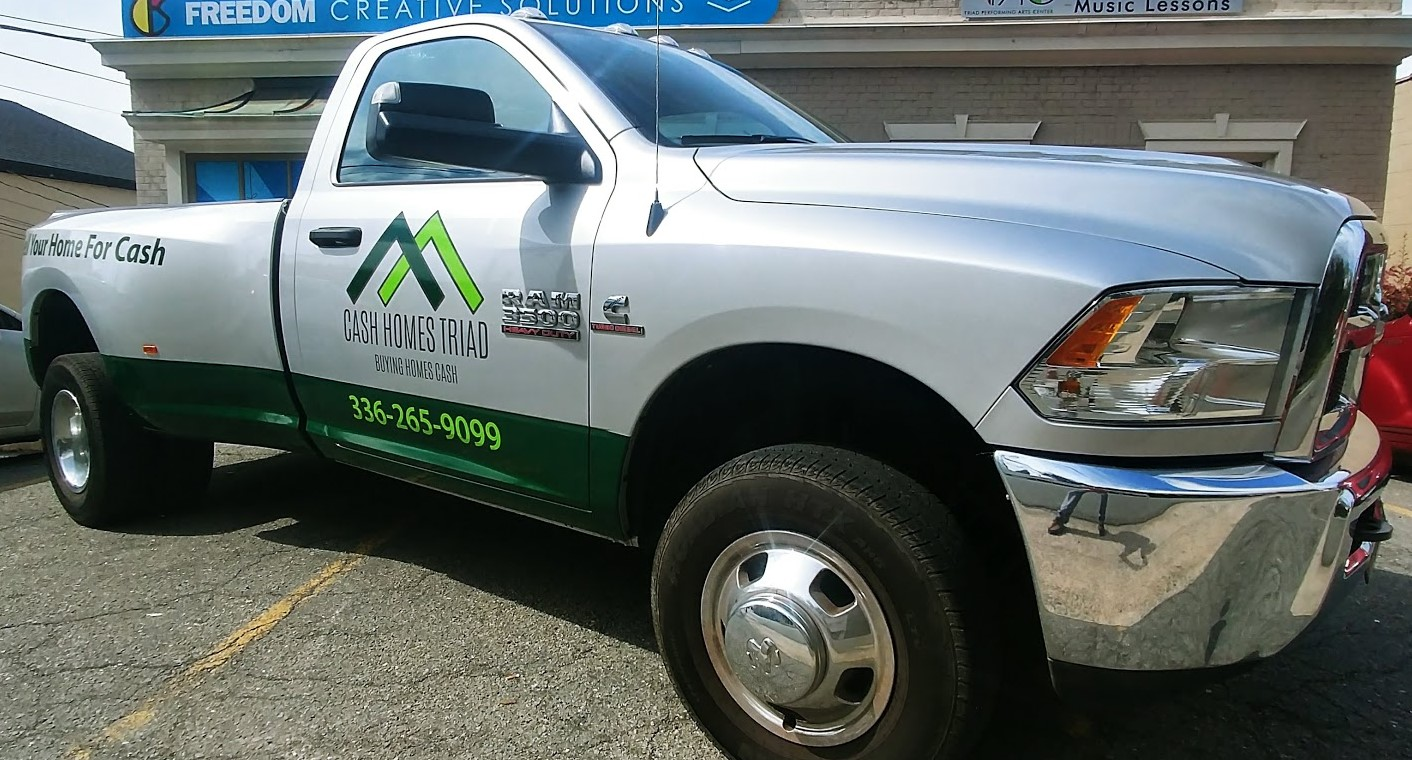 cash_homes_triad_truck_vehicle_wrap_left_front_angle_view