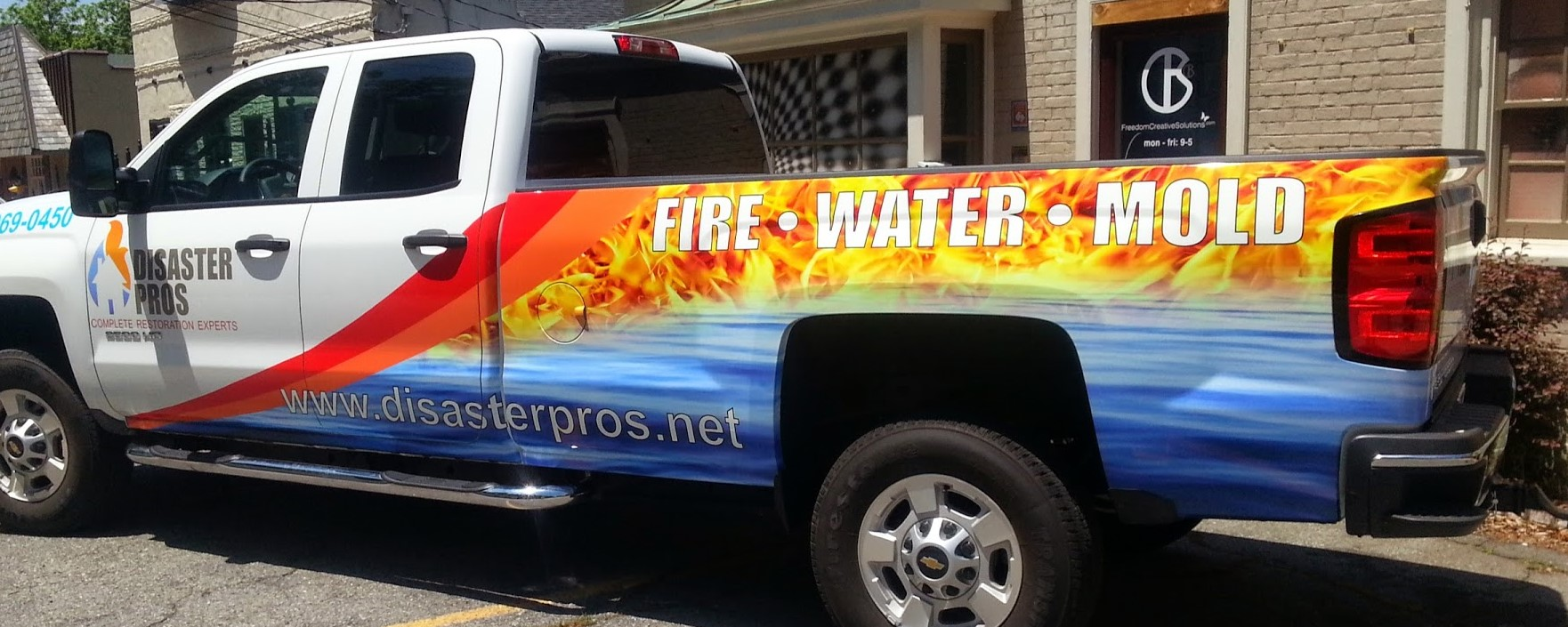 disaster_pros_fire_water_mold_complete_restoration_experts__back_right_angle_view_vehicle_wrap
