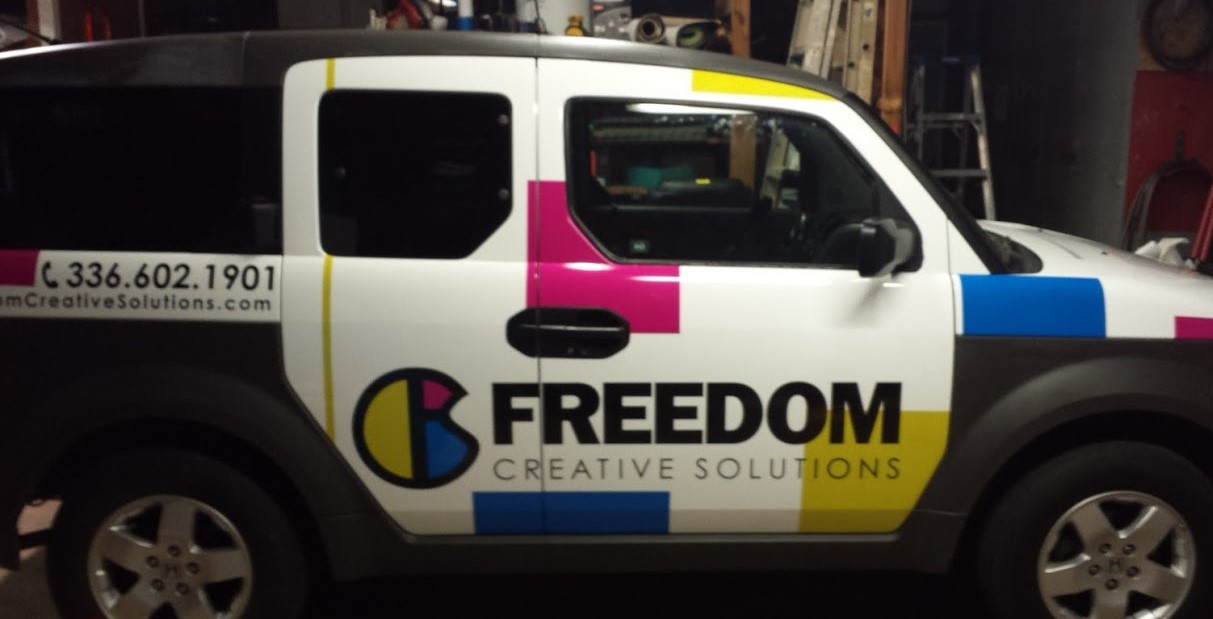 freedom_creative_solutions_company_left_side_view_vehicle_wrap