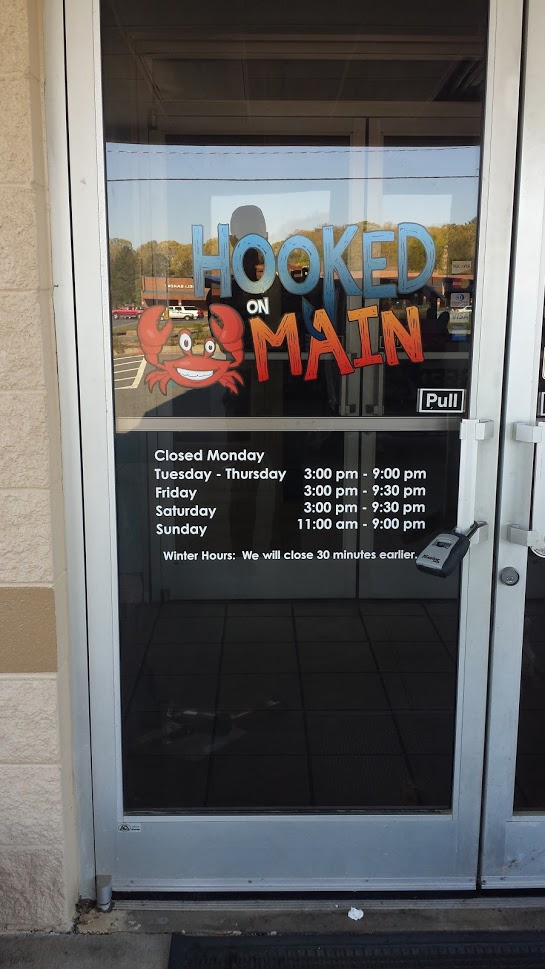 hooked on main door vinyl graphics display