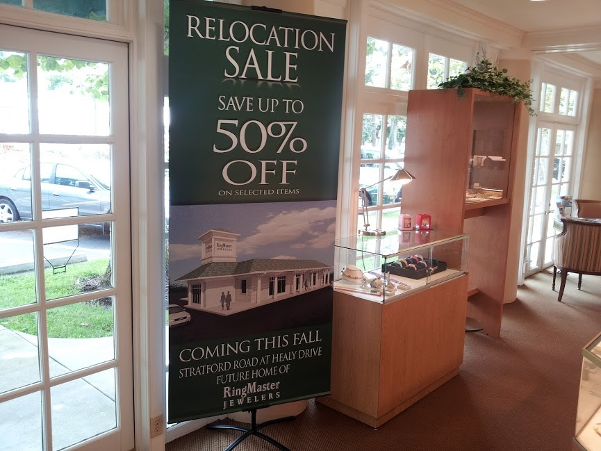ringmaster jewelers relocation banner stand signage
