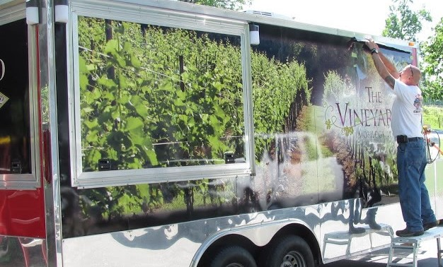 Putting finishing touches on Trailer wrap for Westbend Vineyards outside Winston Salem