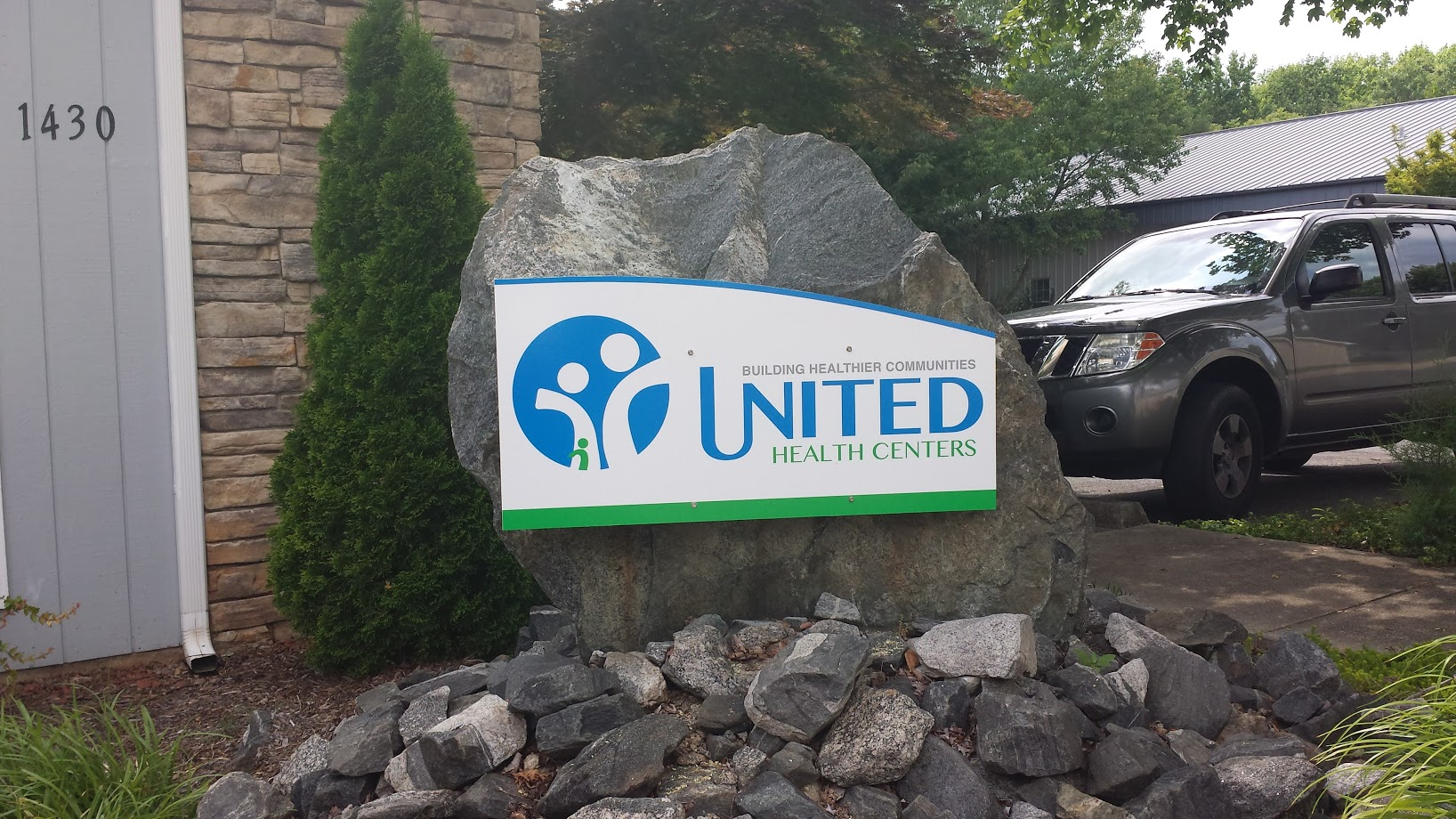 united health centers front rock signage display